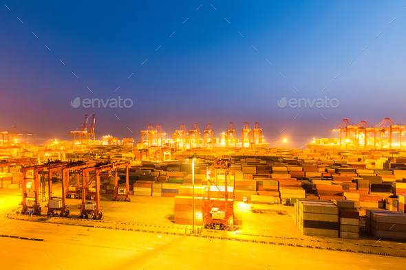 modern shipping harbor at night - Stock Photo - Images