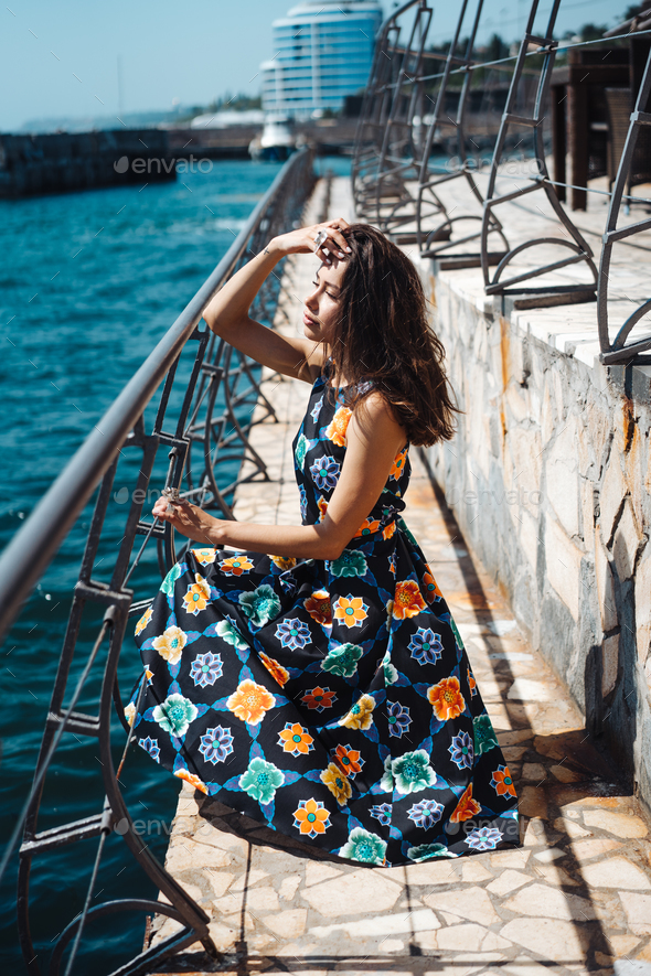 Young pretty woman on the pier near - Stock Photo - Images