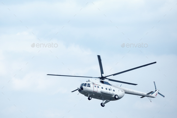 White helicopter in the blue sky - Stock Photo - Images