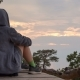 Girl in a Hoodie Sits, and Contemplates the Sky - VideoHive Item for Sale