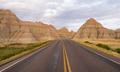 Highway into Rock Formations Badlands National Park South Dakota - PhotoDune Item for Sale
