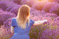 Young woman picking lavender flowers at sunset. - PhotoDune Item for Sale
