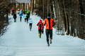 Group athletes running on winter alley