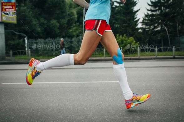 Girl athlete running a marathon - Stock Photo - Images