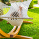 Girl relaxing and listening to music in hammock - PhotoDune Item for Sale