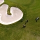 Aerial View of Golfers Playing on Putting Green. Professional Players on a Green Golf Course - VideoHive Item for Sale