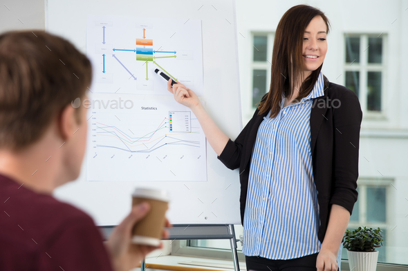Businesswoman Looking Away While Giving Presentation - Stock Photo - Images