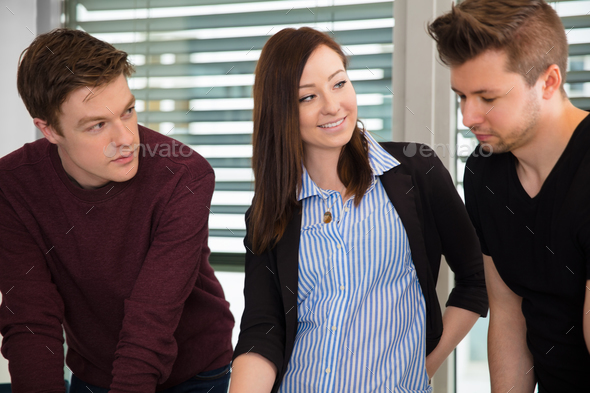 Smiling Businesswoman With Male Colleagues In Office - Stock Photo - Images
