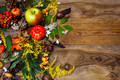 Happy Thanksgiving decor with rowan berries on wooden background
