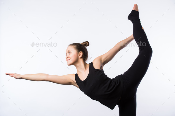 Attractive Woman doing Standing Bow Yoga Pose - Stock Photo - Images