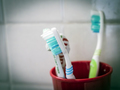 Several toothbrushes in a bathroom