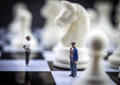 Man thumbnail within a game of chess, concept