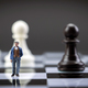 Man thumbnail within a game of chess, concept - PhotoDune Item for Sale