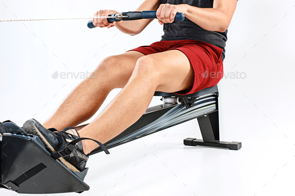 Man Using A Press Machine In A Fitness Club. - Stock Photo - Images