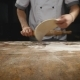 The Chef's Hands Roll the Dough Into Pizza - VideoHive Item for Sale