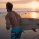 Young Surfer Holding Board, Running To Go in the Water at Amazing Golden Light Sunset. Happy Man - VideoHive Item for Sale
