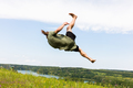 Young man jumping on a hill. - PhotoDune Item for Sale