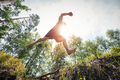 Young man jumping in the forest. - PhotoDune Item for Sale