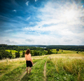 Young man standing on a hill path. - PhotoDune Item for Sale