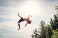 Young man doing a backflip in the air. - PhotoDune Item for Sale