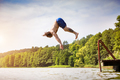 Young fit man jumping into a lake - PhotoDune Item for Sale