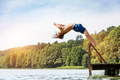 Young fit man jumping into a lake. - PhotoDune Item for Sale