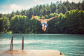 Young fit man making a jump into a lake. - PhotoDune Item for Sale