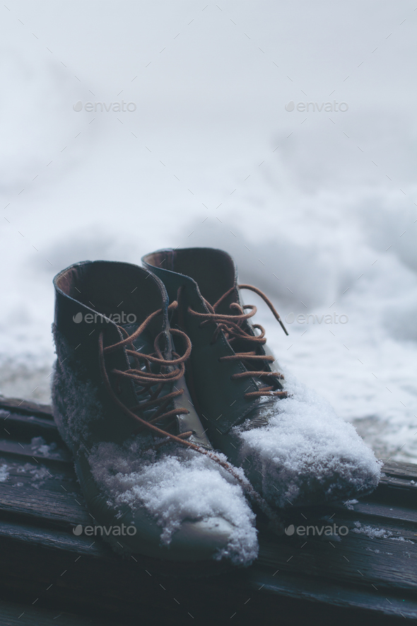 vintage leather shoes covered in snow
