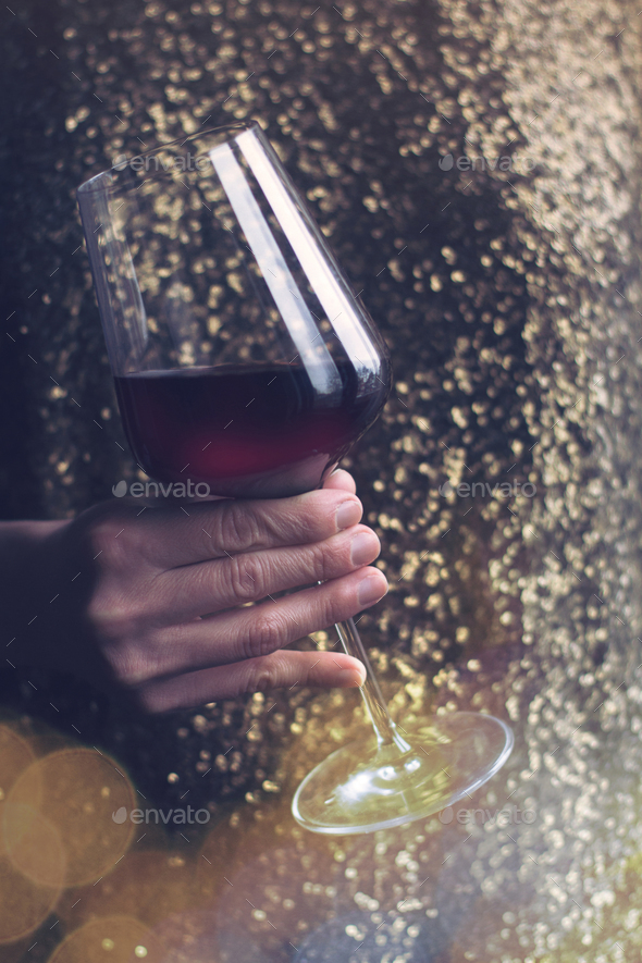 woman with gold spangle dress holding red wine glass - Stock Photo - Images