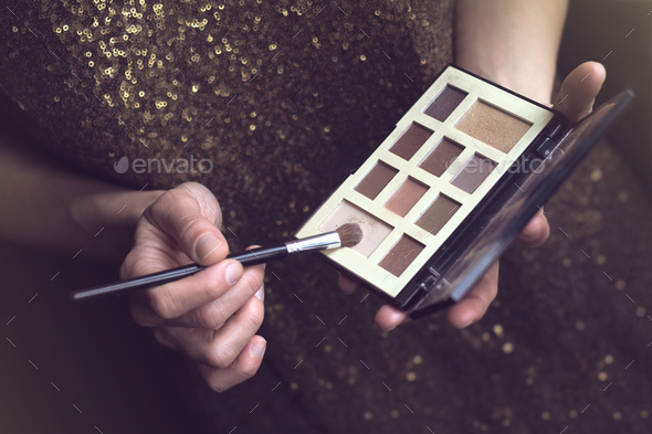 vintage woman with makeup kit - Stock Photo - Images