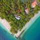 Aerial Driving Off From Small Hidden Beach on Croatian Coast - VideoHive Item for Sale