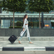 female walking on street with travel bag - PhotoDune Item for Sale