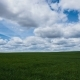 of Clouds Above Endless Green Farmland - VideoHive Item for Sale