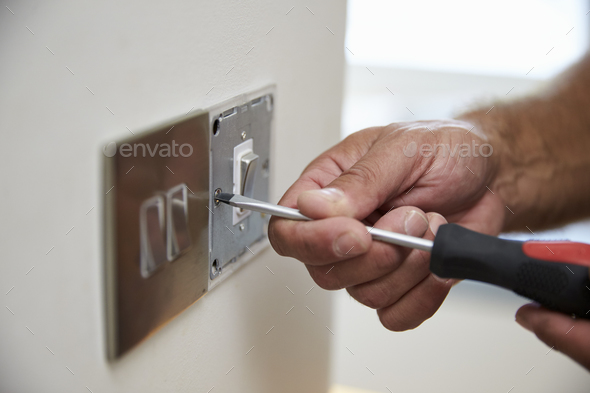 Close Up Of Electrician Repairing Domestic Light Switch - Stock Photo - Images