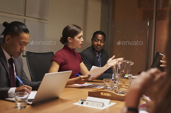 Female manager addressing team at a business meeting - Stock Photo - Images