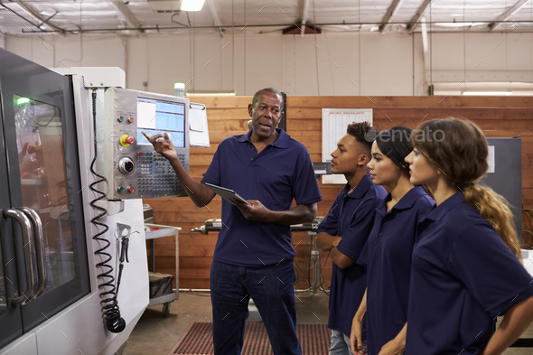 Engineer Training Apprentices On CNC Machine - Stock Photo - Images