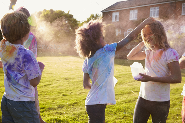 Children Celebrating Holi Festival With Paint Party - Stock Photo - Images