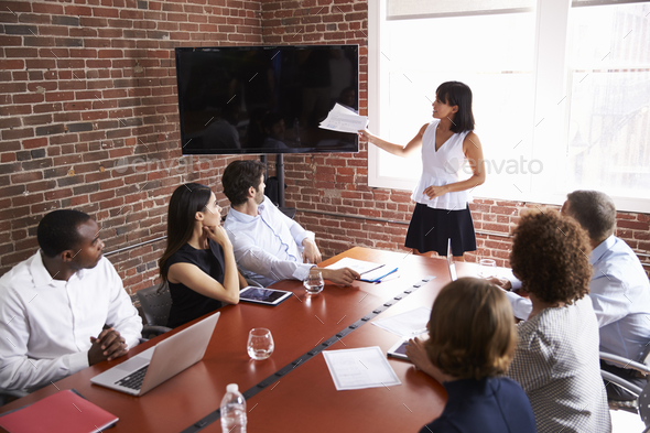 Businesswoman Addressing Boardroom Meeting With Screen - Stock Photo - Images