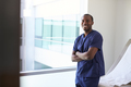 Portrait Of Male Nurse Wearing Scrubs In Exam Room - PhotoDune Item for Sale