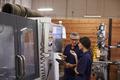 Engineer Training Female Apprentice On CNC Machine - PhotoDune Item for Sale