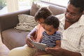 Grandfather And Grandchildren At Home Using Digital Tablet - PhotoDune Item for Sale