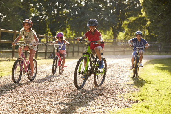 Four Children On Cycle Ride In Countryside Together - Stock Photo - Images