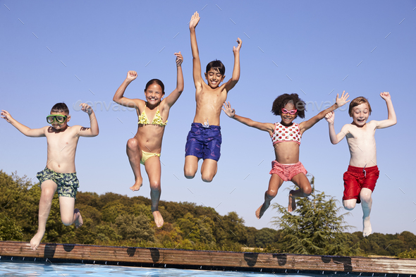 Group Of Children Jumping Into Outdoor Swimming Pool - Stock Photo - Images