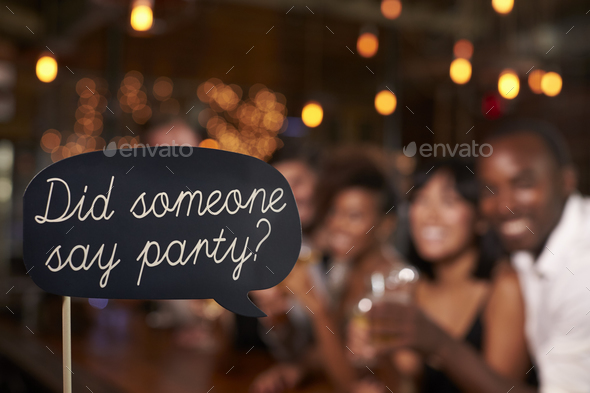 Sign at a party, defocussed celebrations in the background - Stock Photo - Images