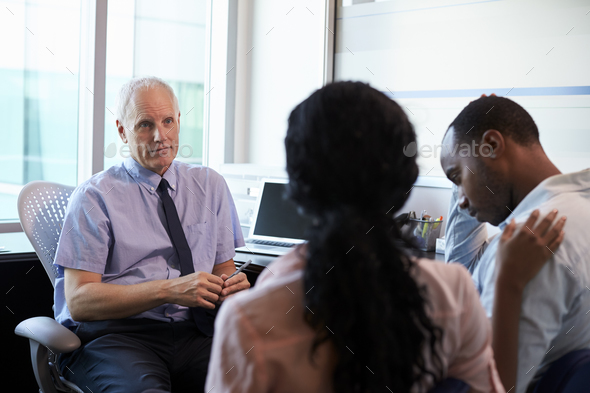 Doctor Treating Couple Suffering With Depression In Office - Stock Photo - Images