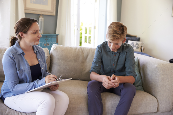 Teenage Boy With Problem Talking With Counselor At Home - Stock Photo - Images