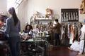 Multi ethnic team working together in clothes design studio