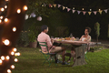 Young black couple relaxing at dinner in a garden