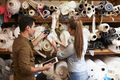 Man and woman selecting fabric from storage shelves - PhotoDune Item for Sale