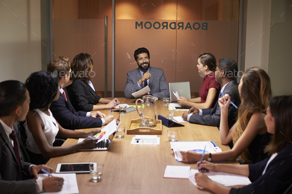 Corporate business people at an evening boardroom meeting - Stock Photo - Images